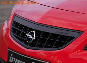 Решетка радиатора Opel Astra J Хэтчбек, Sports Tourer (дорестайлинг) с планкой в дизайне Carbon-Look