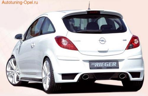 Обвес на Opel Corsa D с глушителем с выхлопом на две стороны от компании Rieger с шелкографией под карбон