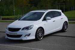 Накладка на бампер передний Opel Astra J Хэтчбек, Sports Tourer (дорестайлинг)