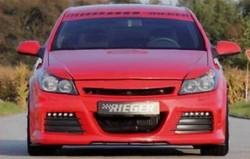 Обвес на Opel Astra H GTC со штатным глушителем от компании Rieger с шелкографией под карбон