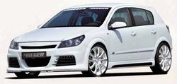 Обвес на Opel Astra H 5-ти дверная со штатным глушителем от компании Rieger с шелкографией под карбон