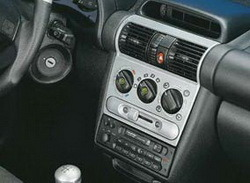 Комплект отделки приборной панели и салона Opel Corsa B, Opel Tigra в стиле Alu-Look для машин без отопления сидений, с электрозеркалами без электроподъемников стекол