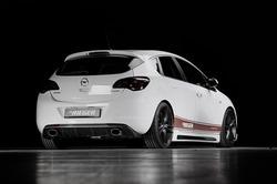 Обвес на Opel Astra J 5-ти дверная от компании Rieger с глушителем слева и справа с шелкографией под карбон