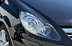 Реснички на фары Opel Corsa D